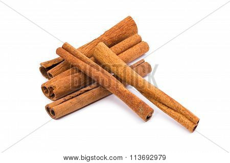 Five Sticks Of Cinnamon On A White Background