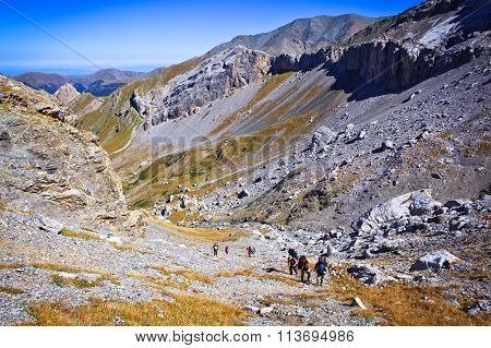 Group Of Hiking Tourists To Climb To The Mountain Pass