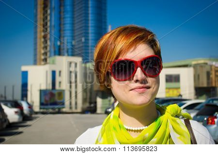 Portrait Of Young Beautiful Red-haired Woman In The Parking