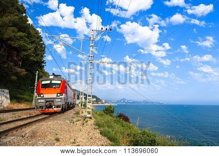 A  Red Train Goes Along The Shore