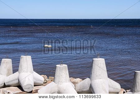Breakwaters On The Bank Sea Closeup