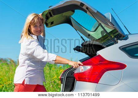 Woman Closes The Trunk Of The Car Type Hatchback