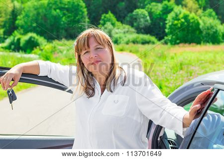 Portrait Of Happy Woman Outdoors Near The Car