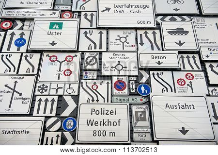 Traffic signs at the exterior wall of the Swiss Museum of Transport in Lucerne, Switzerland.
