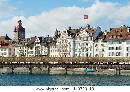 View to the old bridge and historical buildings in Lucerne, Switzerland.