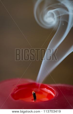 Extinguished Red Candle With Smoke