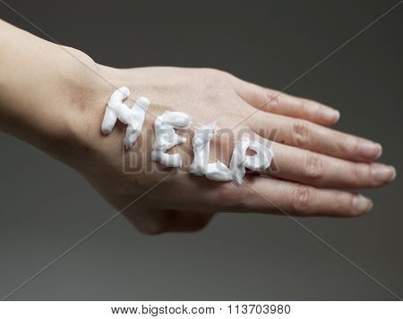 Skin Care Concept / Help Note with Moisturizer Cream on Dry Skin Hand