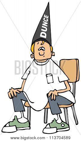 Boy wearing a dunce hat