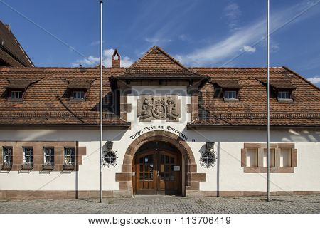 NUREMBERG, GERMANY - AUGUST 23, 2015: The tavern Tucher Bräu is located at the Frauentorgraben close to the Opera of Nuremberg