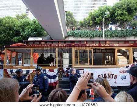 Giants Fans Take Photos With Smart Phones Of Players On Trolley Car