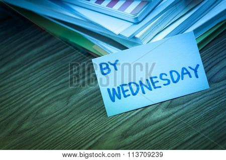 By Wednesday; The Pile Of Business Documents On The Desk