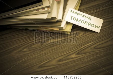 Meeting Tomorrow; The Pile Of Business Documents On The Desk
