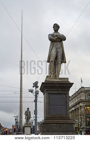 DUBLIN, IRELAND - JANUARY 05: Statue of William Smith O'Brien with Millennium Spire in the background, in overcast day. January 05, 2016 in Dublin