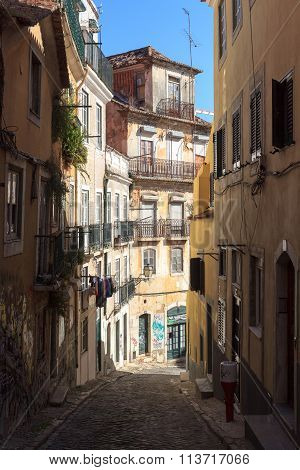 Typical small Alley with sunshine in Lisbon, Portugal
