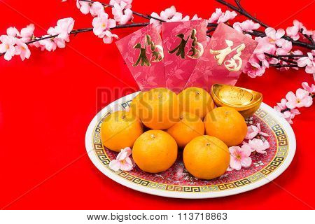 Mandarin Oranges And Red Packets With Chinese Good Luck Character