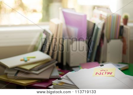 Do Now; Stack Of Documents. Working Or Studying At Messy Desk.