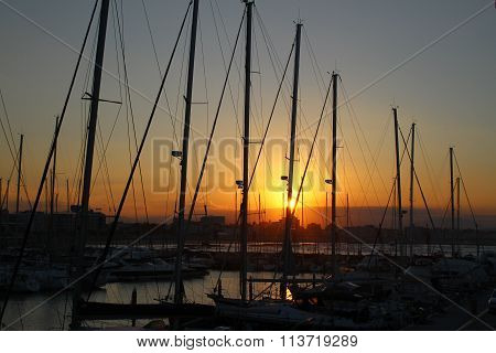 Masts of sailboats at sunset. Gabicce Mare, Italy
