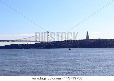 25 de Abril Bridge with Christ the King Statue in Lisbon