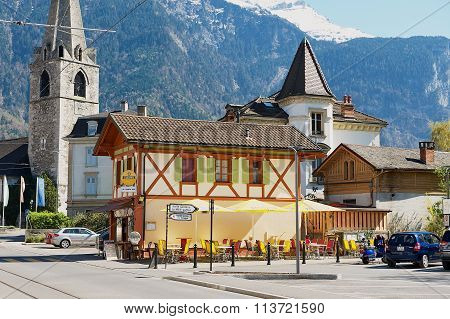 View to the street and historical buildings of Bex in Bex, Switzerland.