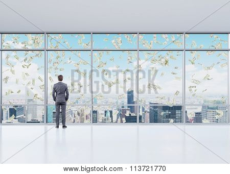 Man In An Office In Front Of The Window