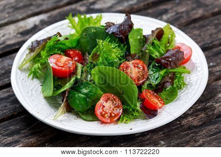 Fresh Green Vegetable Mixed Salad On Wooden Table