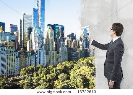 Businessman Covering New York View With Paint