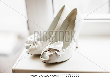 white wedding shoes with a bow