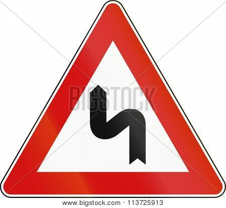 Road Sign Used In Italy - Double Curves, First Curving To The Left