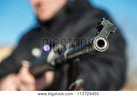 Soldier Or Sniper Holding Gun With Virtual Screen Projection And Aiming In Forest