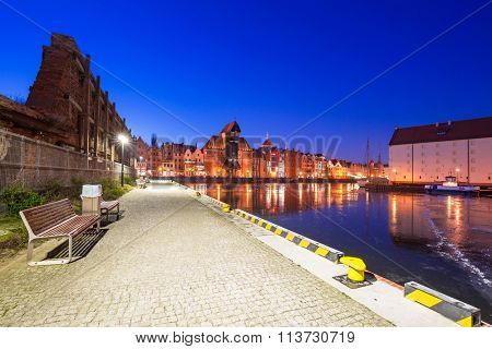 Old town of Gdansk at frozen Motlawa river, Poland
