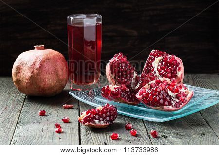 Pomegranate Juice And Slices Of Pomegranate With Grains