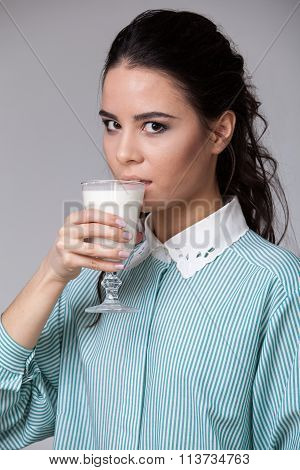Young Brunette With A Glass Of Milk