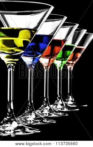 Row of martini glasses on black background in vertical format