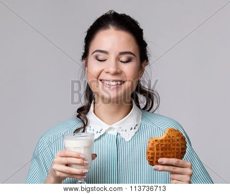 Young Brunette  With A Glass Of Milk And A Bisquit