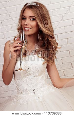 Gorgeous Young Bride With Blond Curly Hair, Wears Elegant Wedding Dress And Crown