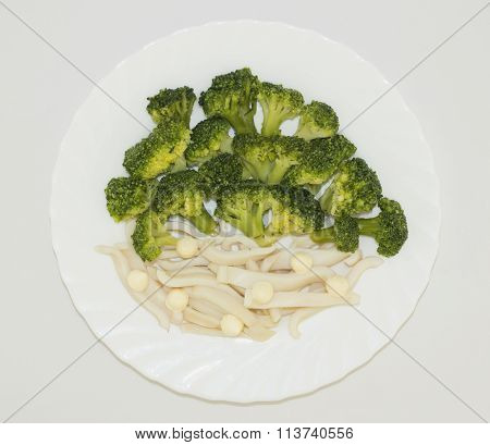 Top view of broccoli with squid in a plate