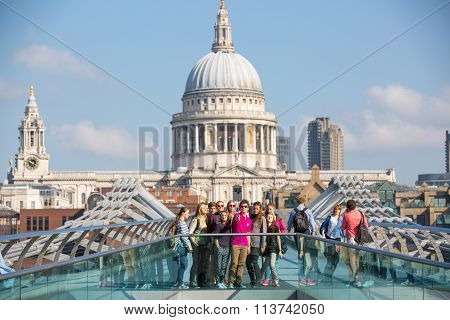LONDON,  St. Paul's cathedral and tourists making selfie at millennium bridge