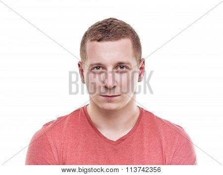 Man looks into the camera.