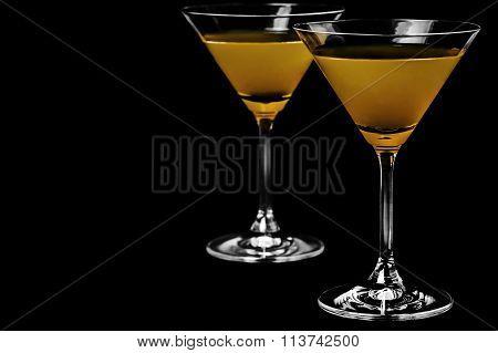 Close-up of martini on black background