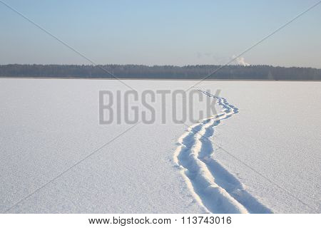Snow On The Surface Of The Frozen Lake