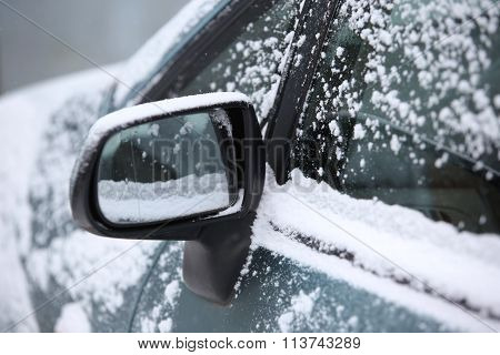 Snow Around Car Mirror