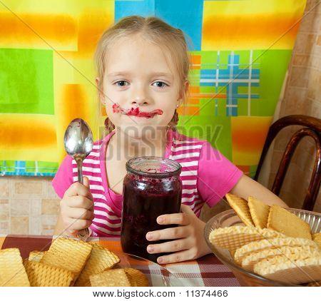 Little Girl Eating Jam