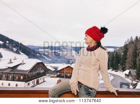 Woman On Balcony Overlooking Mountains Looking Into The Distance