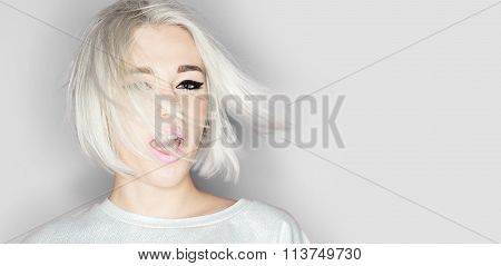 Close-up Portrait Of A Fashion Blonde With Stylish Short Hairstyle On Gray Background