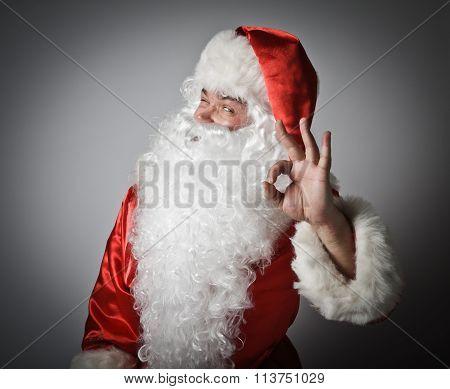 Santa Claus And Sign Of Okay.