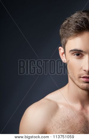 Cheerful young guy with perfect athletic body