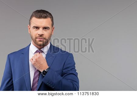 Cheerful businessman is caring of his image