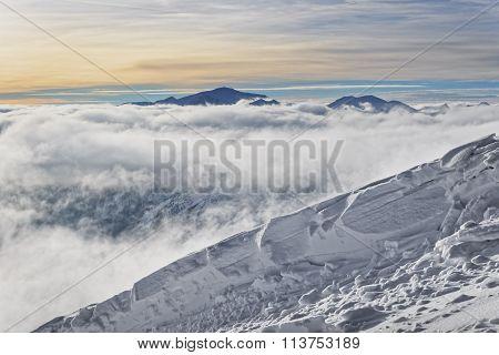 Sun And Clouds Atop Of Kasprowy Wierch Of Zakopane In Tatras In Winter