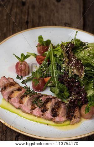 Meatloaf with lettuce, basil, arugula and sesame