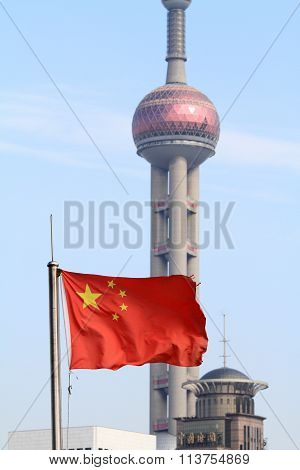 Five-star Red Flag (national flag of China) and Oriental pearl tower in Shanghai